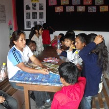 One of the teachers preparing the crafts